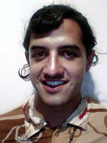 A head shot of actor Raul de Nieves.