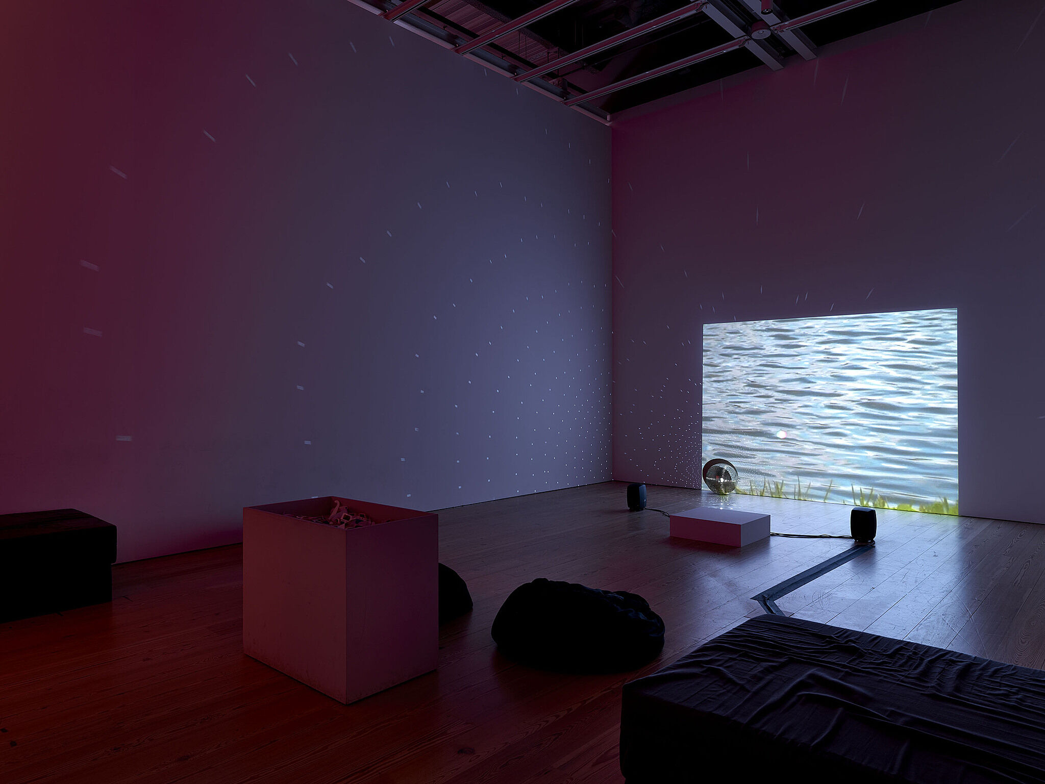 A video installation showing a body of water.