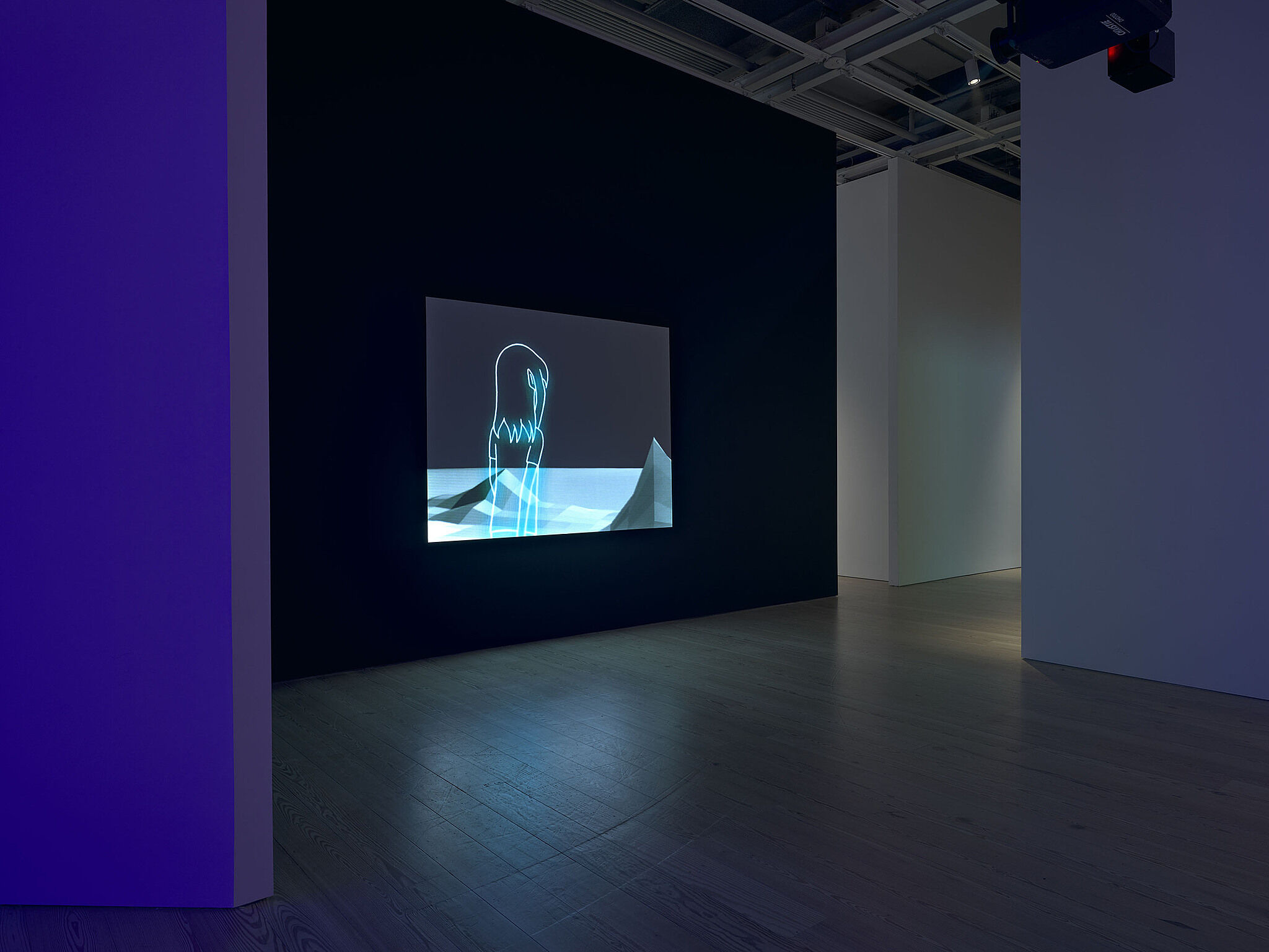 A video installation in a gallery with purple walls.