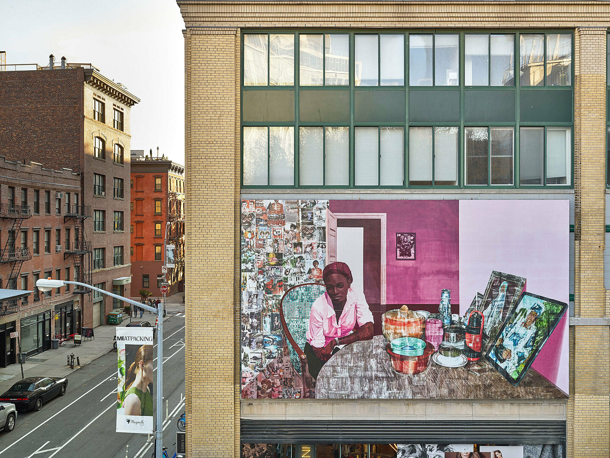 Large painting sits on a building outside of the Whitney Museum.