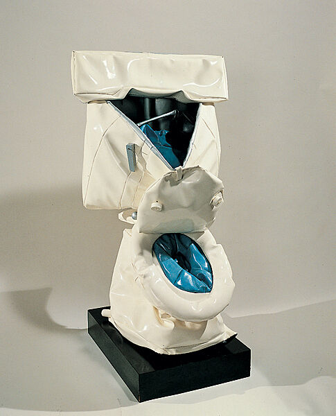 A sculpture of a toilet in disrepair.