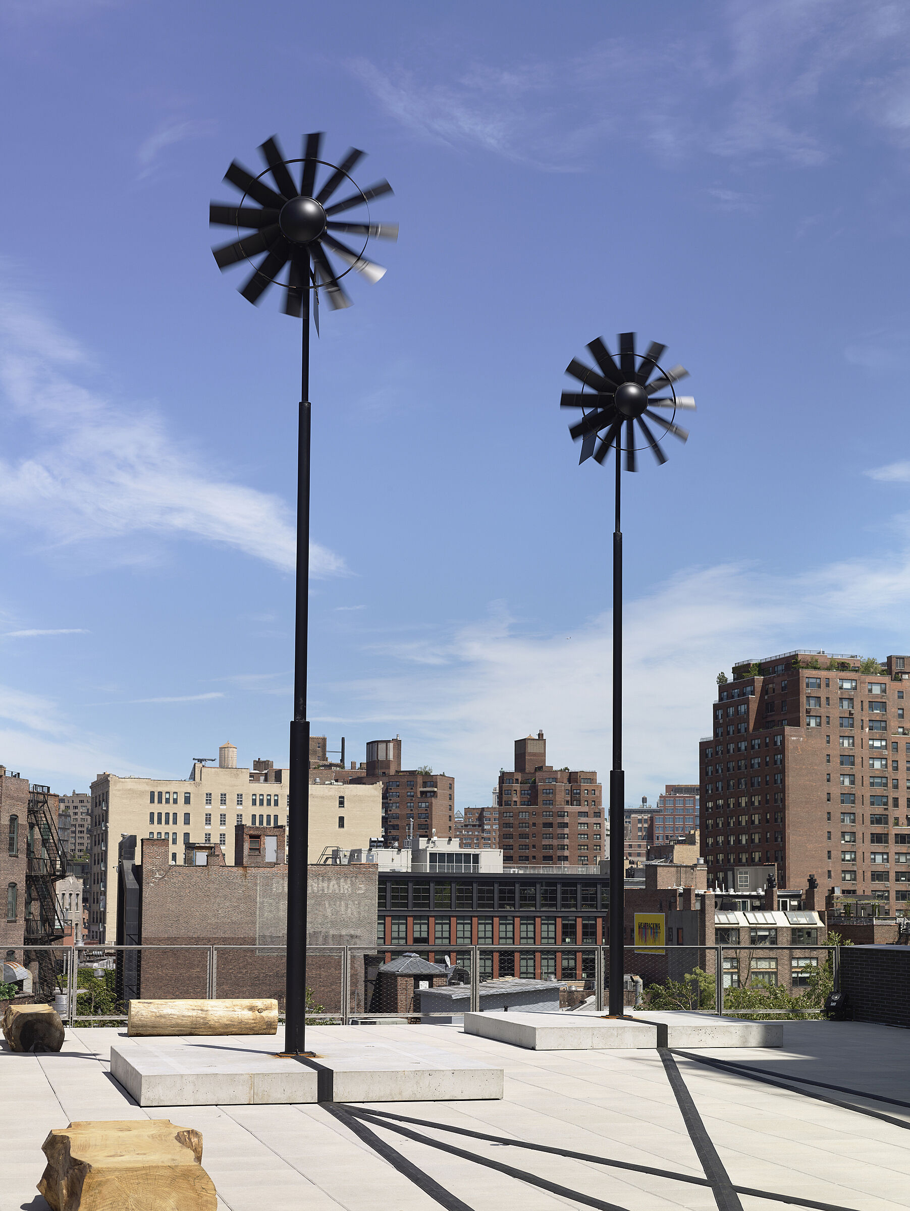 An art installation with windmills on a terrace of the Whitney Museum.