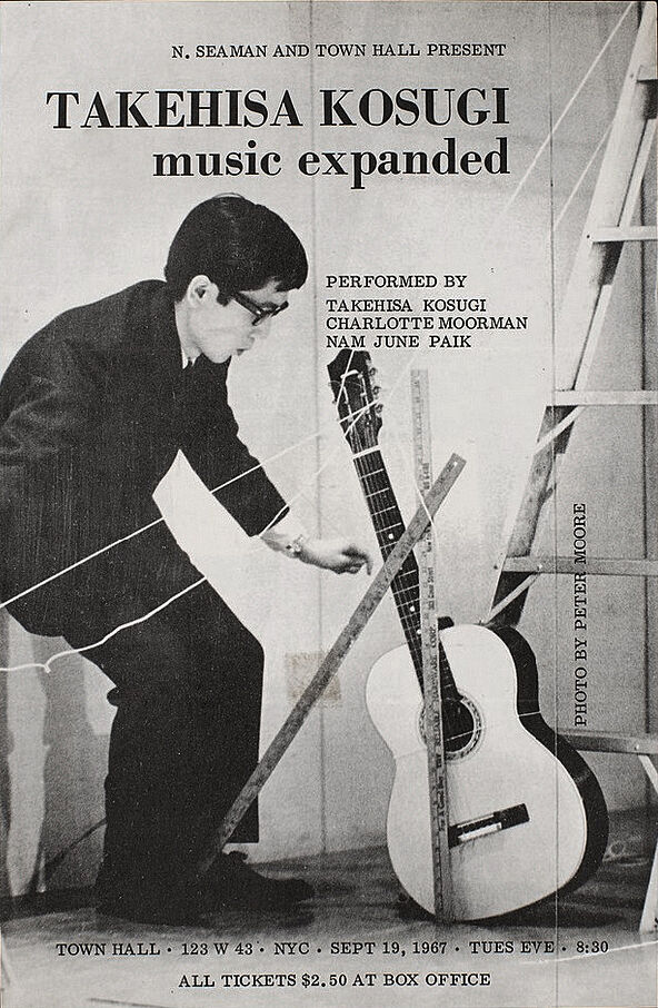 Poster of the artist with a guitar.