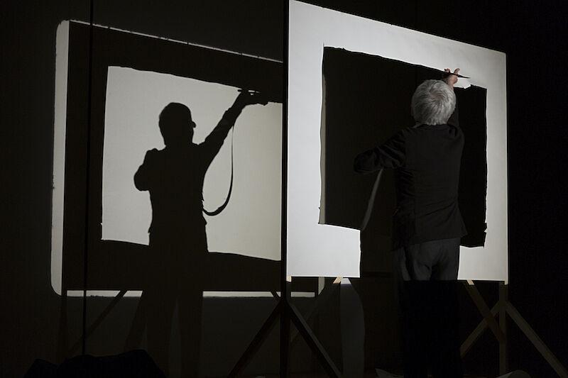 Artist against a black and white frame.