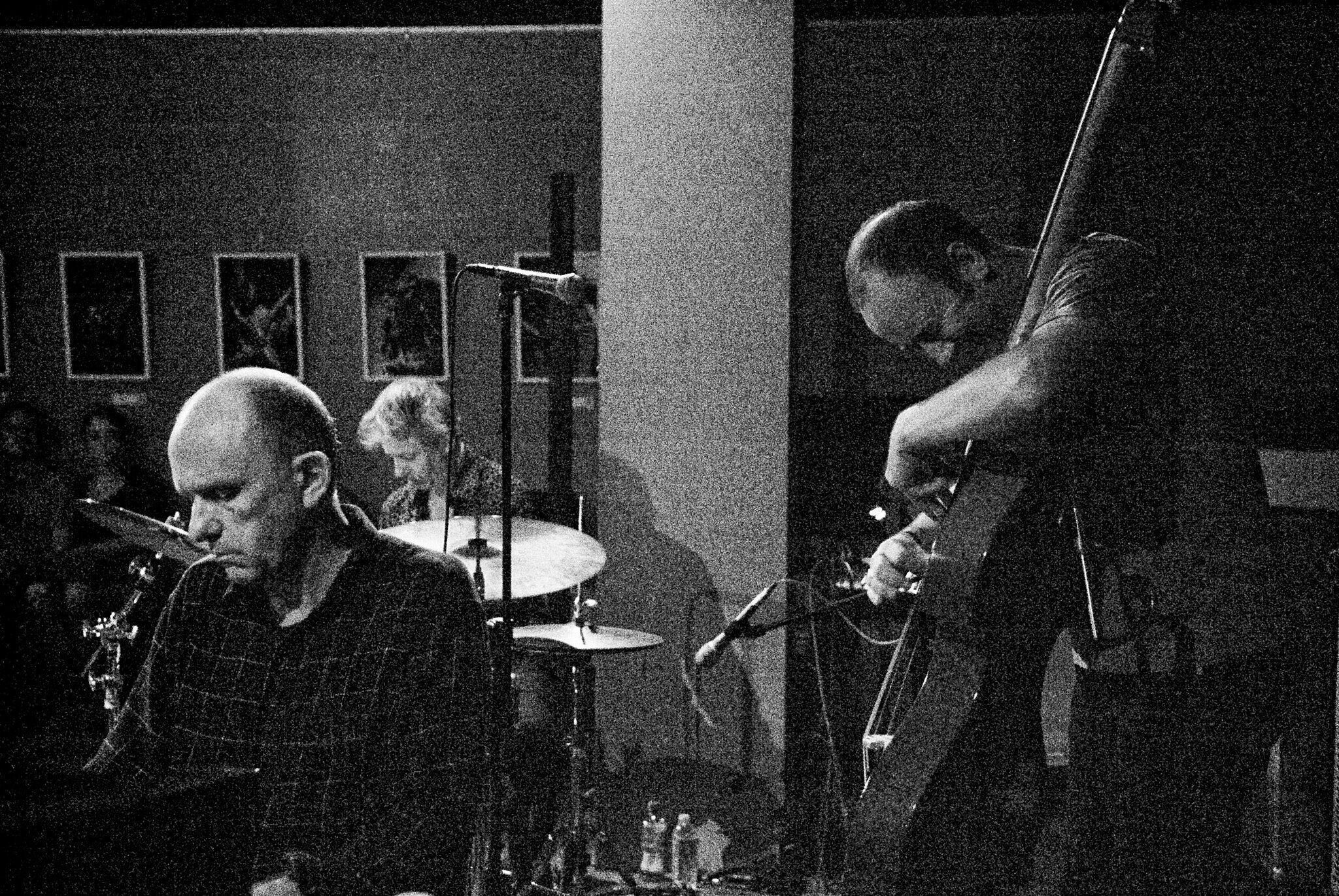 The Necks playing music in a black and white photo.