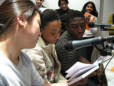 Students recording in a studio.
