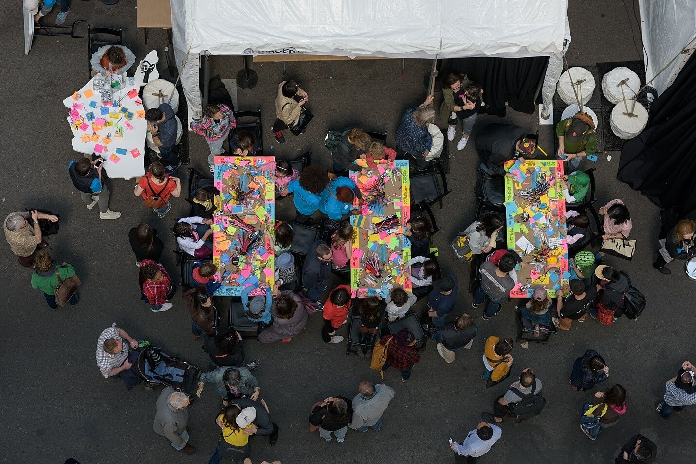 Looking down on people making art at tables.