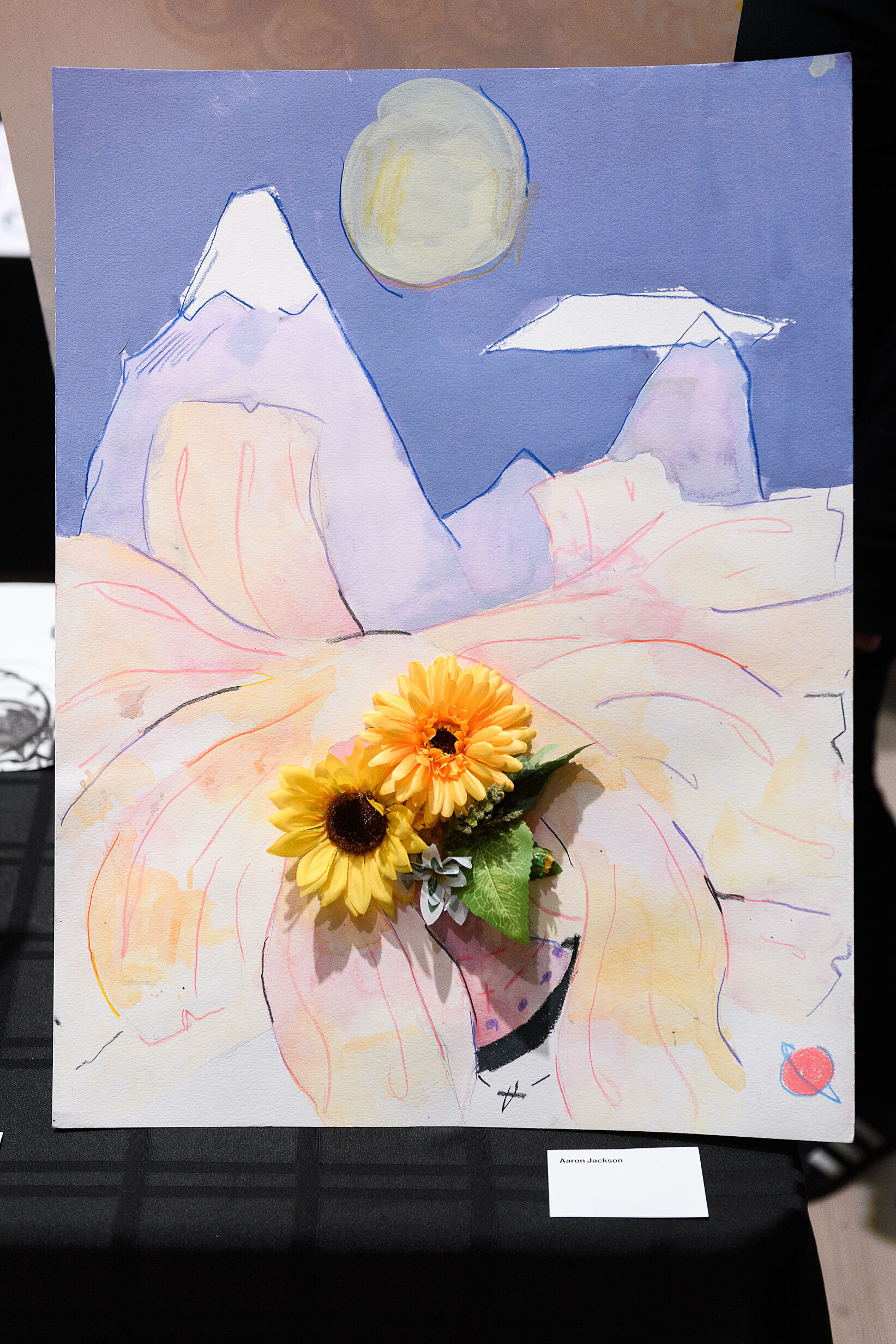 Mixed media of flowers and a landscape.