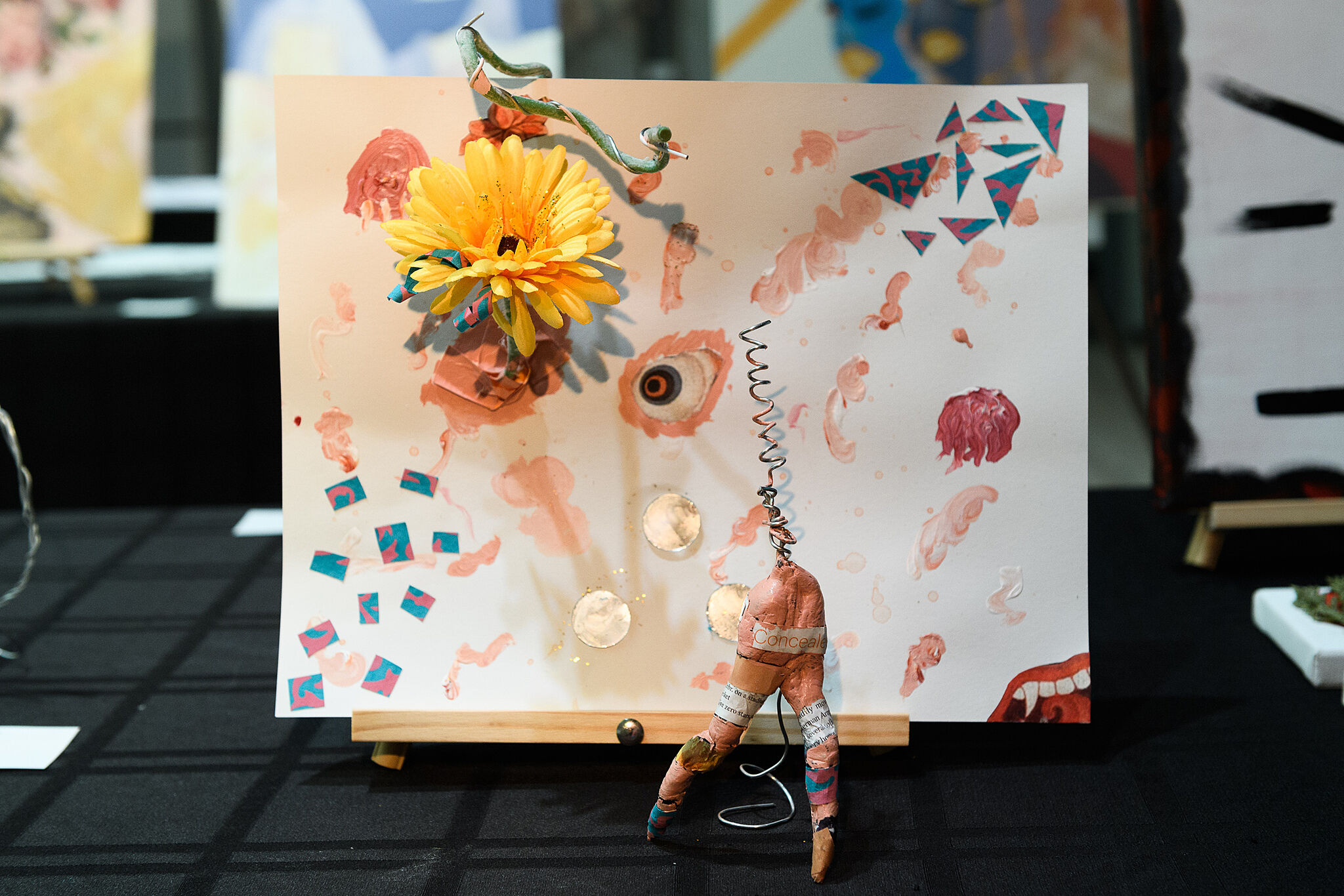 Painting with a flower in it.