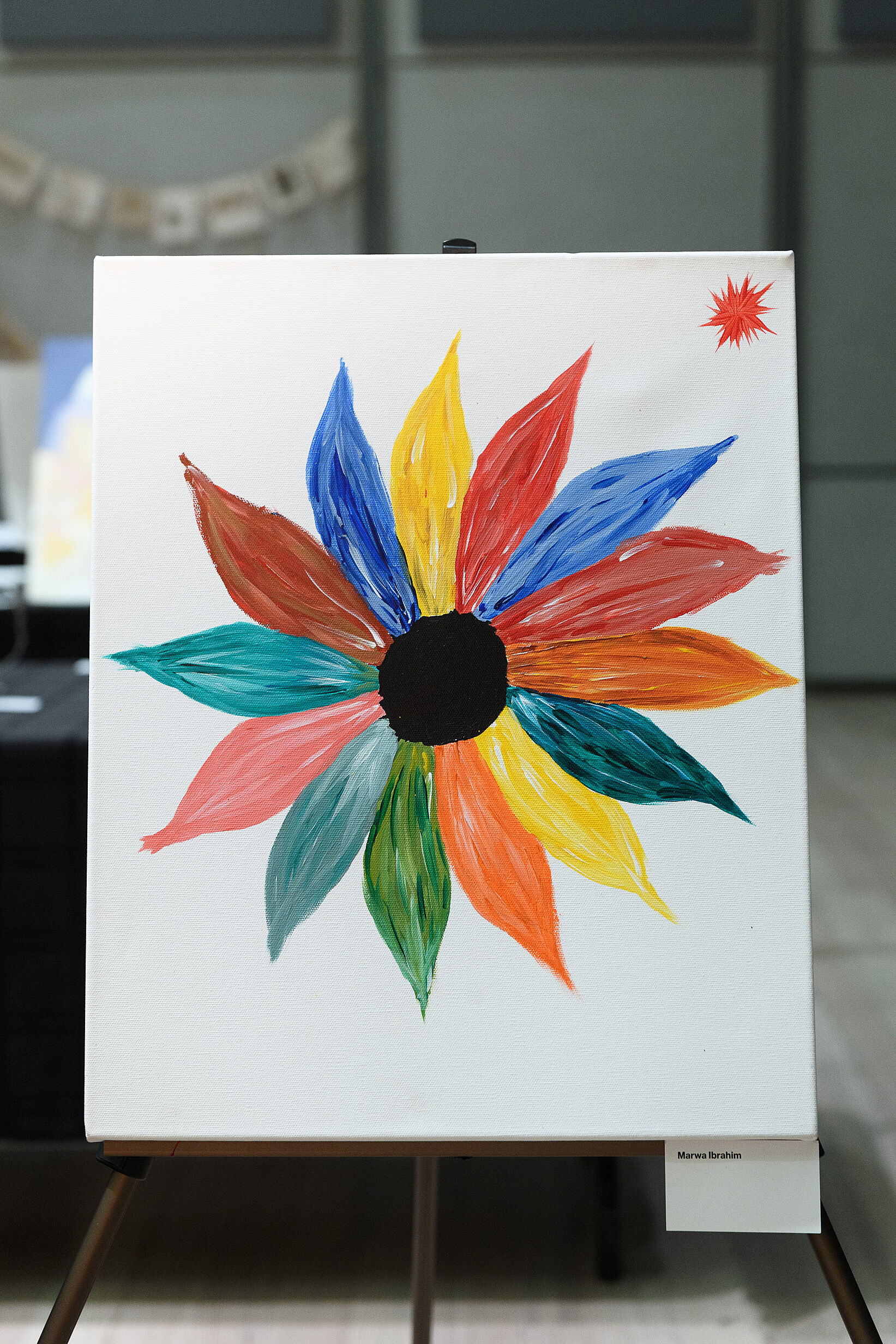 Brightly colored flowers on a white canvas.