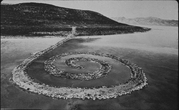 Black and white photo of a spiral jetty
