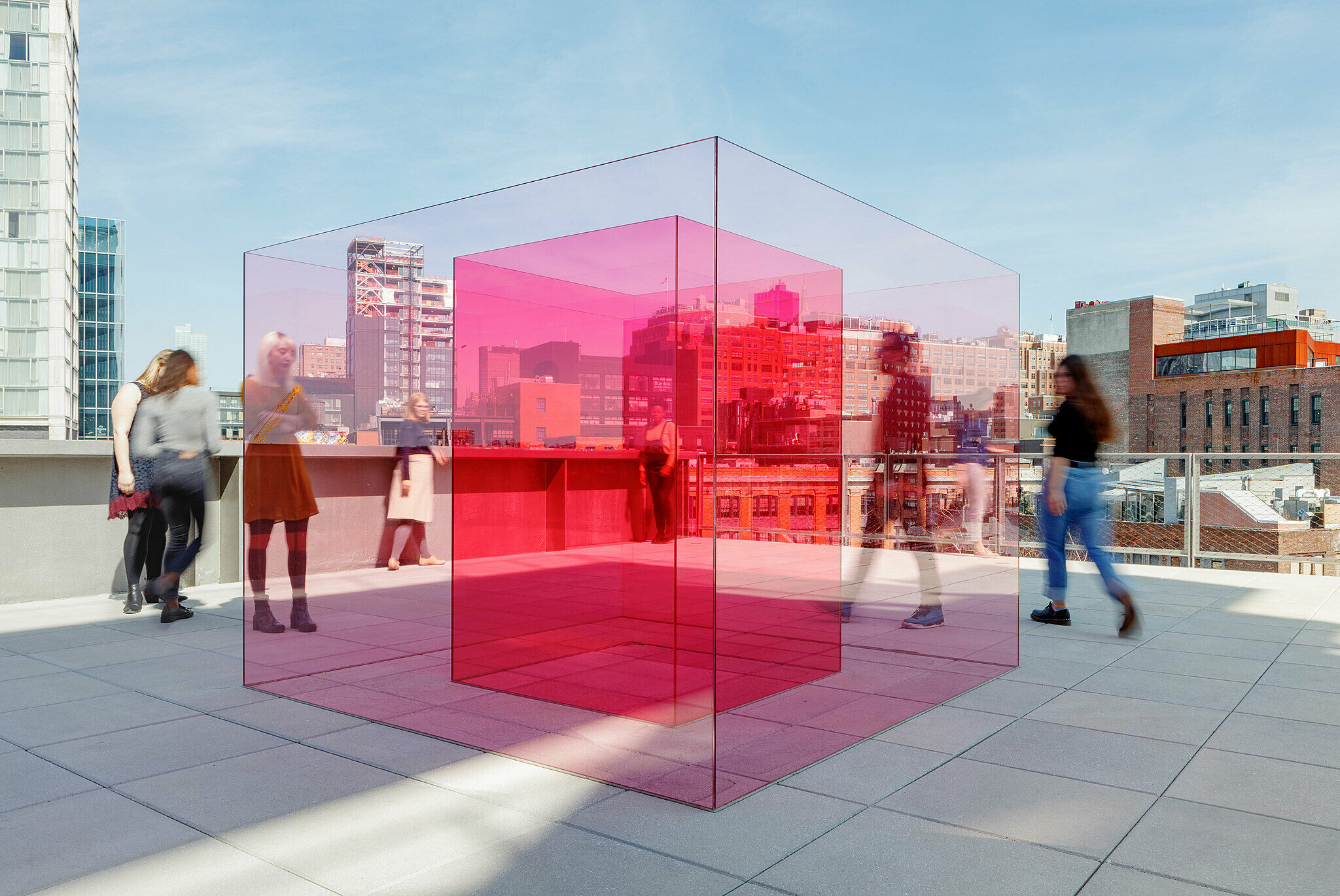 Overhead view of six red cubes on terrace