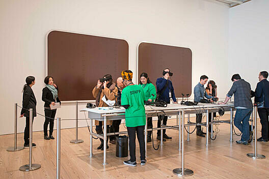 museum visitors using virtual-reality headsets