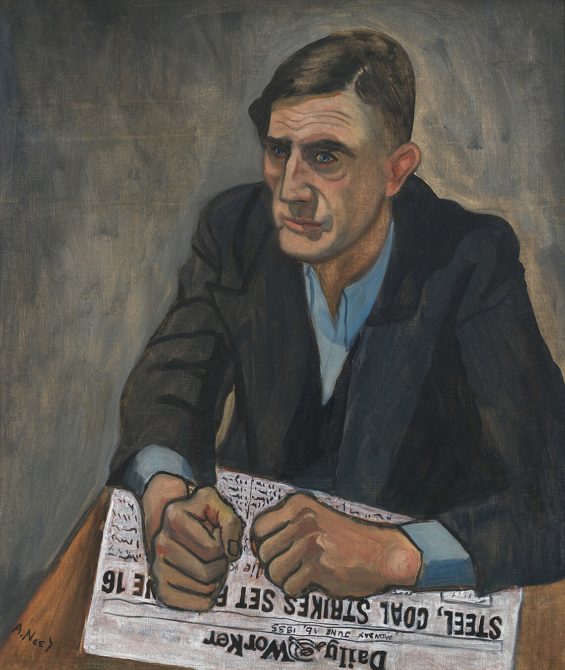 A man sits at a table, staring off into the distance with his closed fists on top of a newspaper