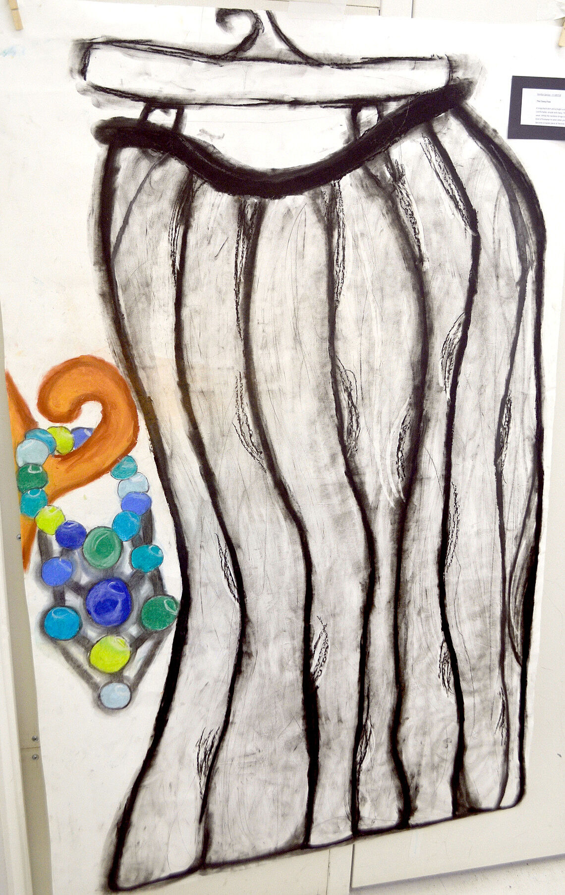 Drawing of a skirt on a hanger.