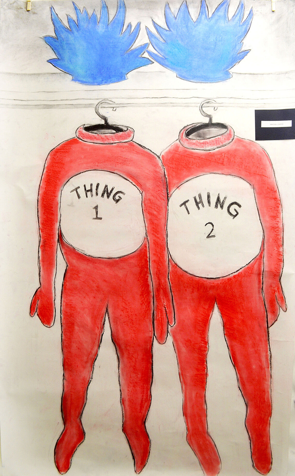 A drawing of two red costumes.
