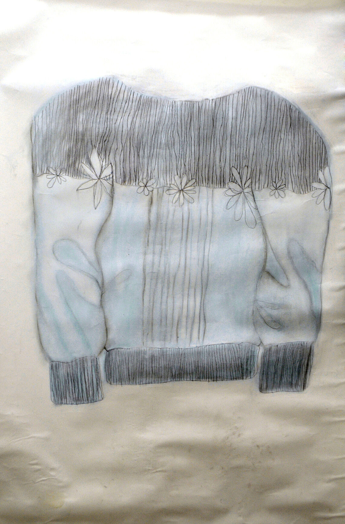 A drawing of a jacket with blue, white, and black shades.