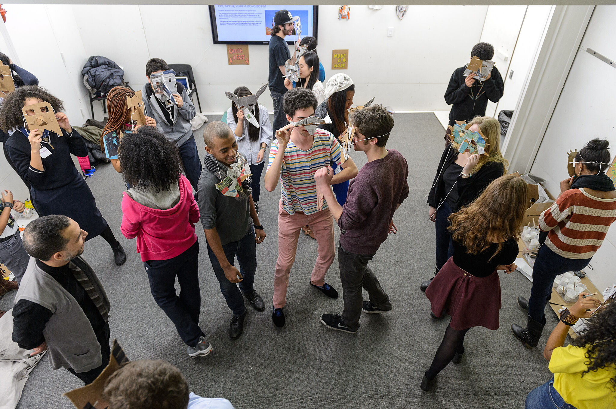A group of students standing in the gallery.