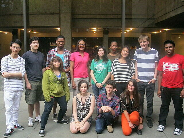 Teen artists leaders posing together in front of the Whitney Museum.