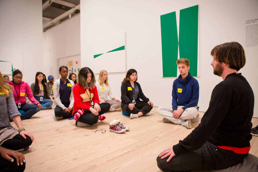 Artist Leidy Churchman meditates with YI Artists.