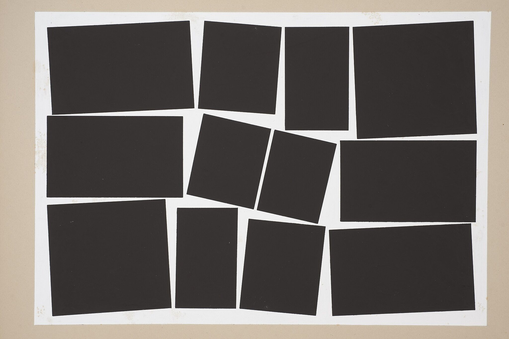 Black squares arranged in a grid on cardboard.
