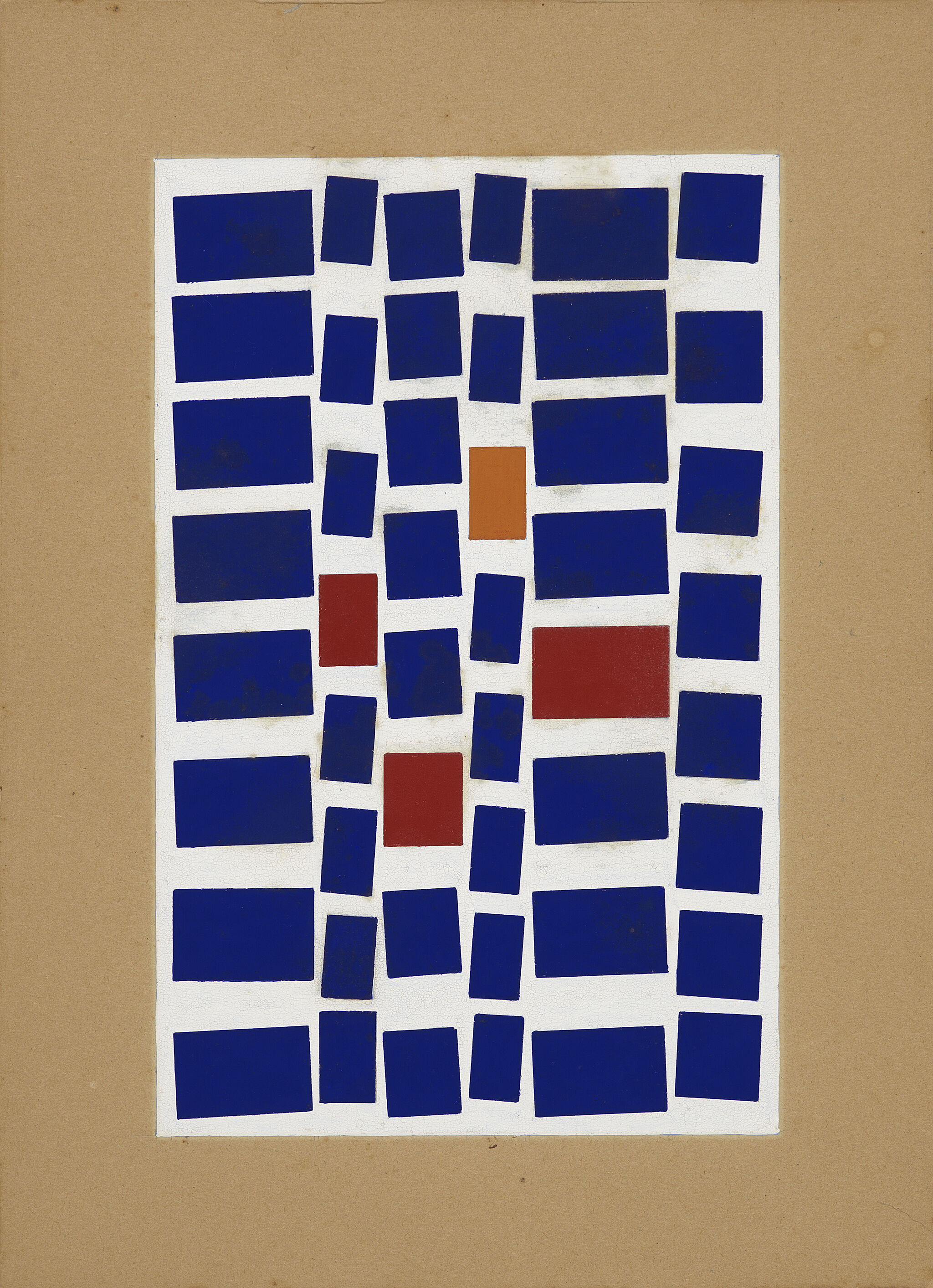 Dark blue, red, and orange squares arranged in a grid on cardboard.