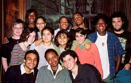 Group photo of teens in front of a glass window.