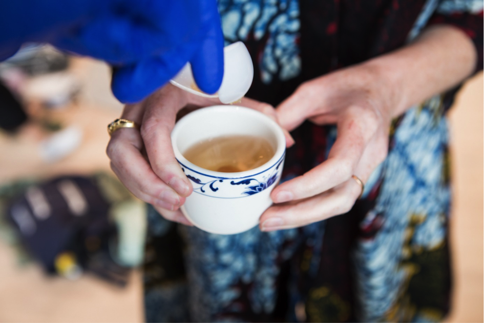 a guest is poured a cup of tea