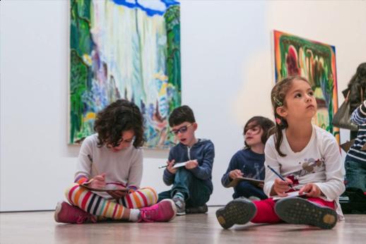 Students sketch in the Biennial galleries