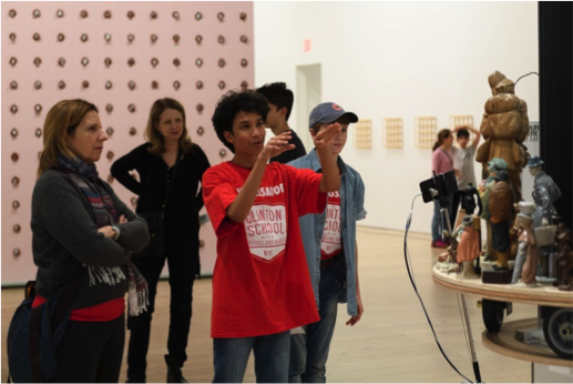 A Clinton student leads a discussion with his family and peers in the galleries