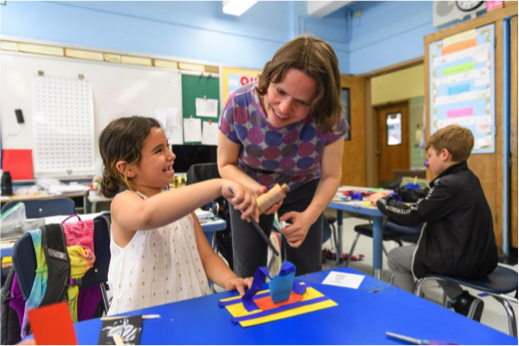 Whitney educator helps a student in the classroom