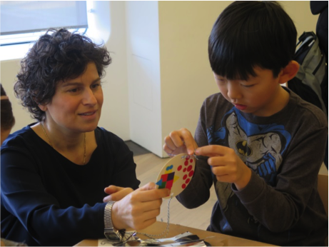 Artist Jenny Perlin works with student to make art