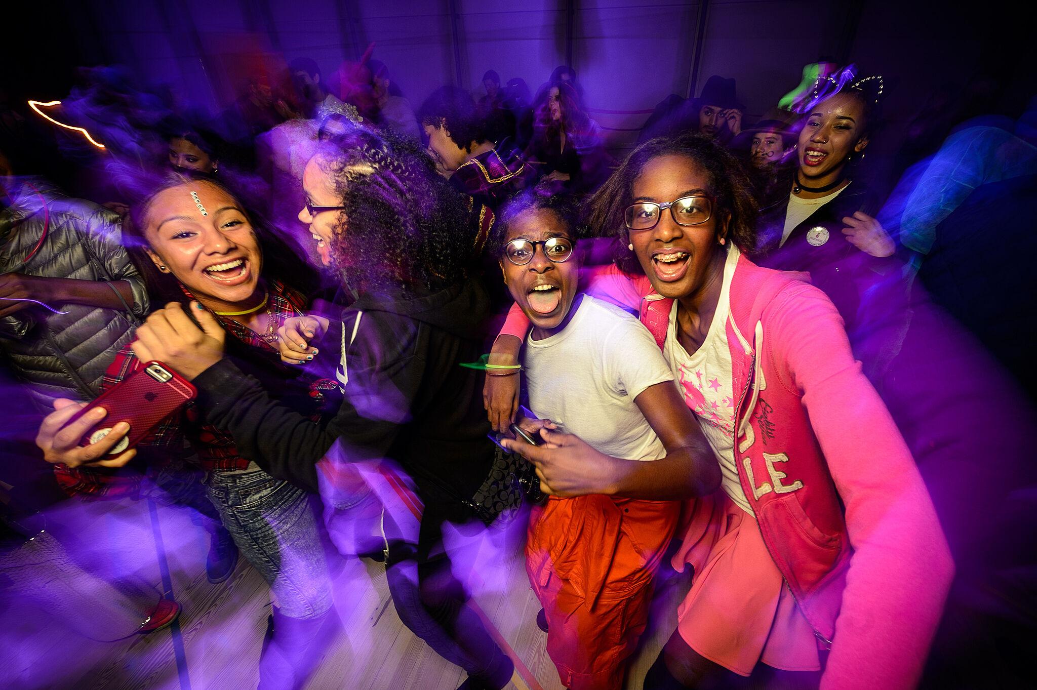 Three teens celebrate Halloween at the Whitney Museum.