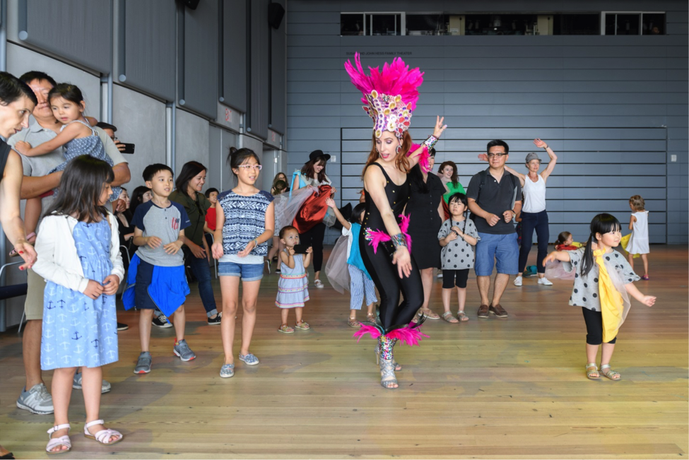 Dancers teach families some Samba moves