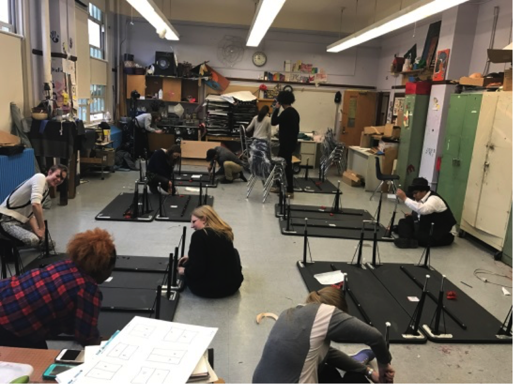 students work to move the classroom