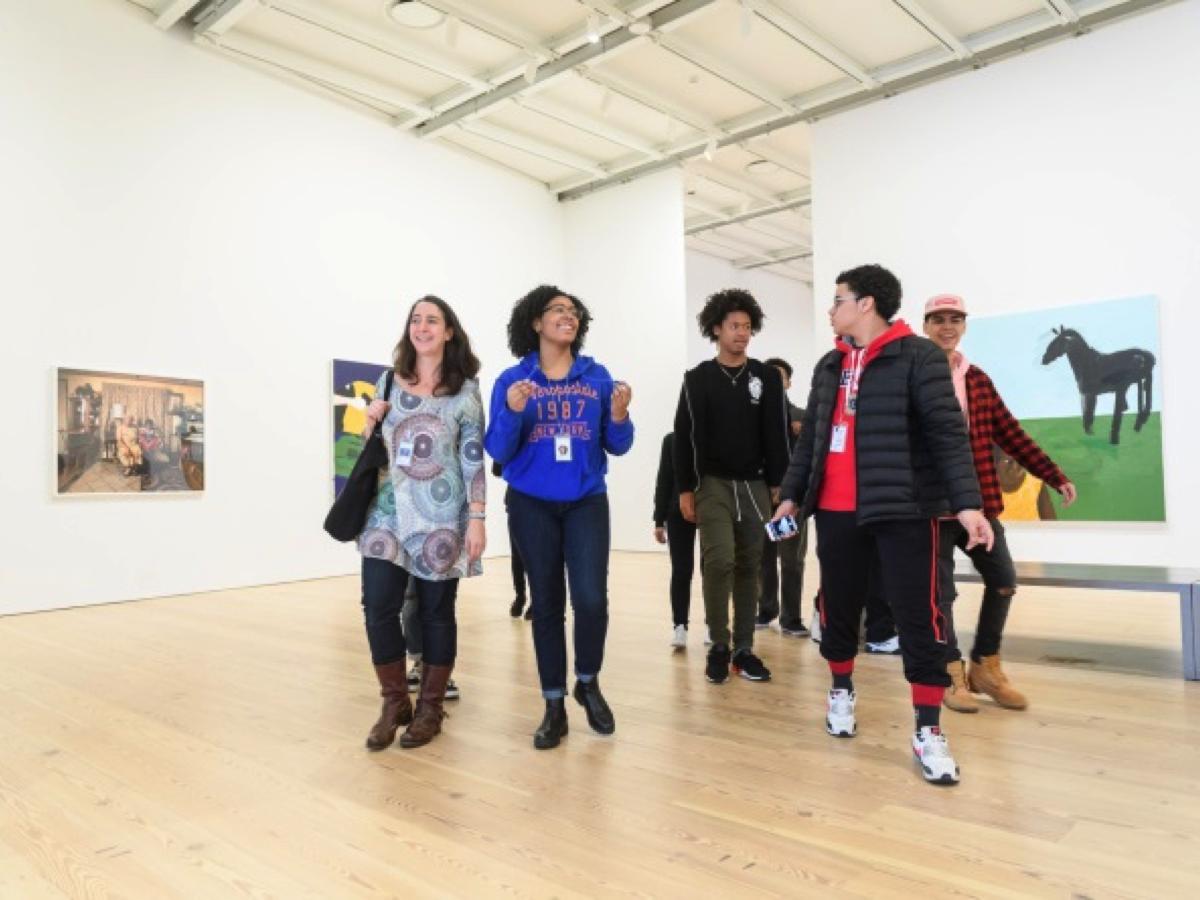 Educator walks students around the Biennial