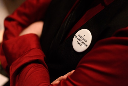 "An ""I Survived Reeducation Camp"" button, distributed during Svenonius's performance lecture"