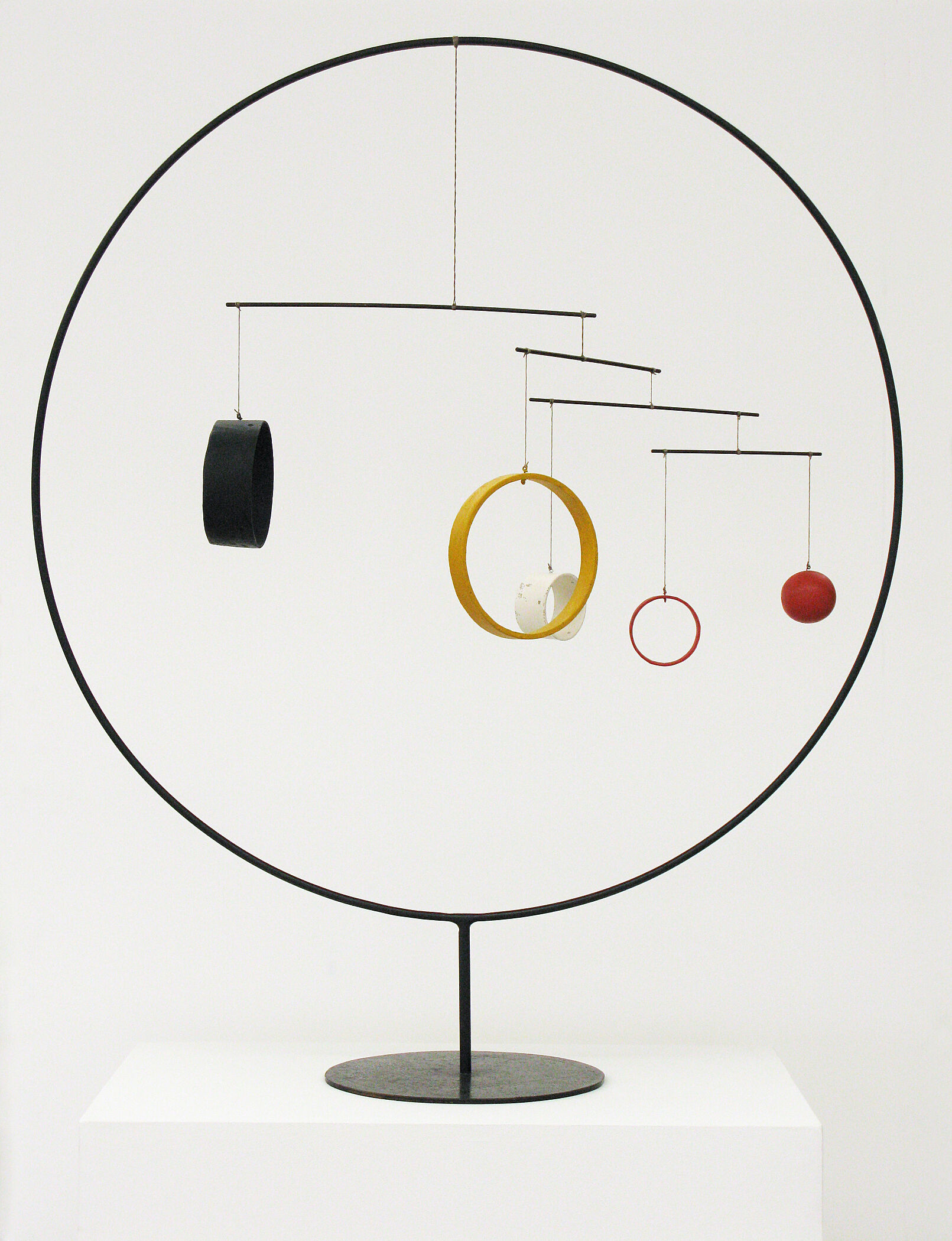 Empty circle with smaller spheres and circles hanging from the top.