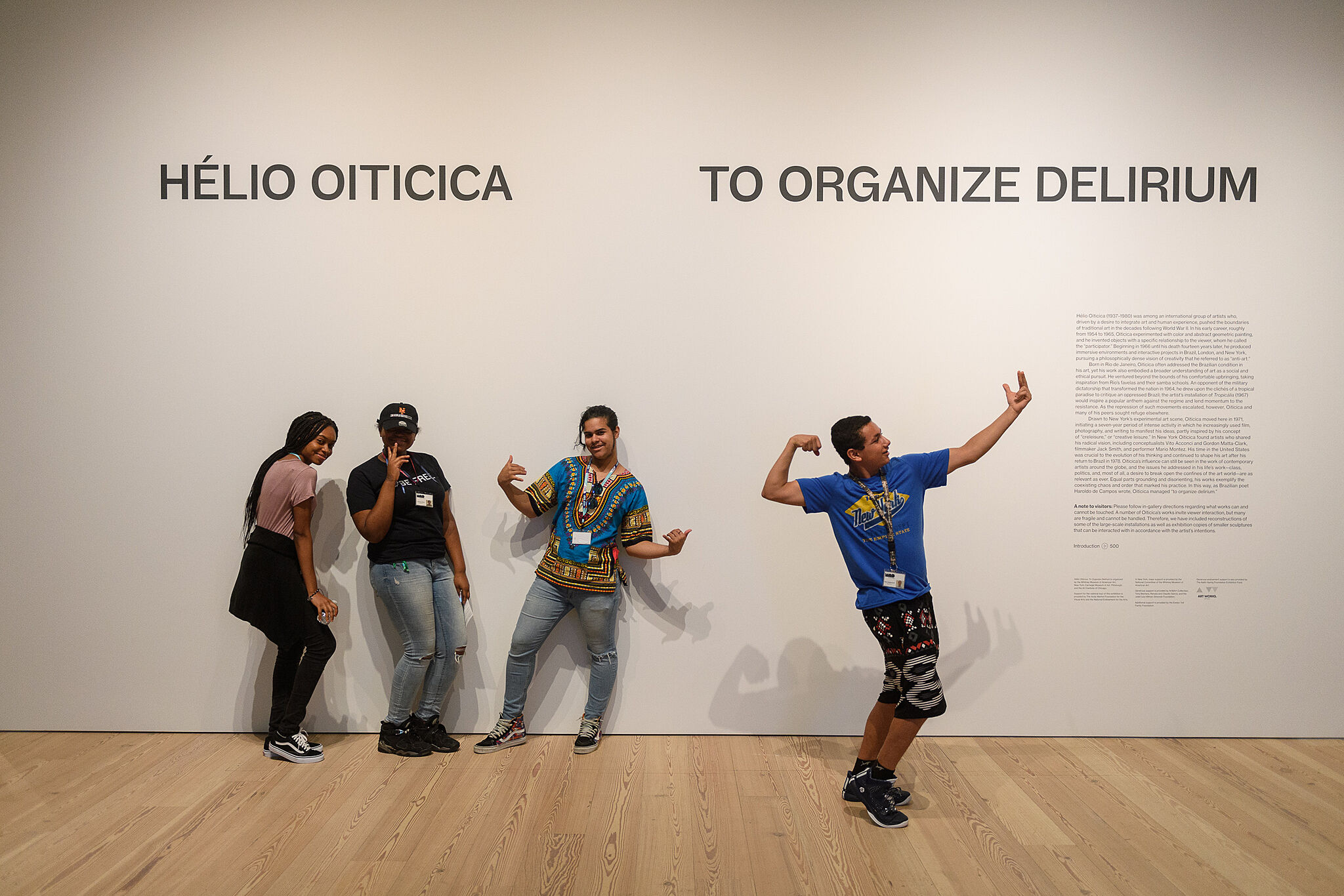 teens posing in front of Helio Oiticica exhibition sign