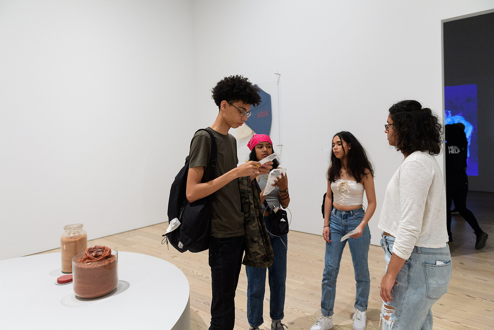 teens standing in a group discussing