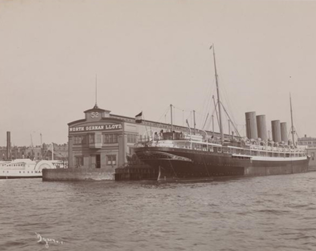 A sepia photo of a boat docked at a pier