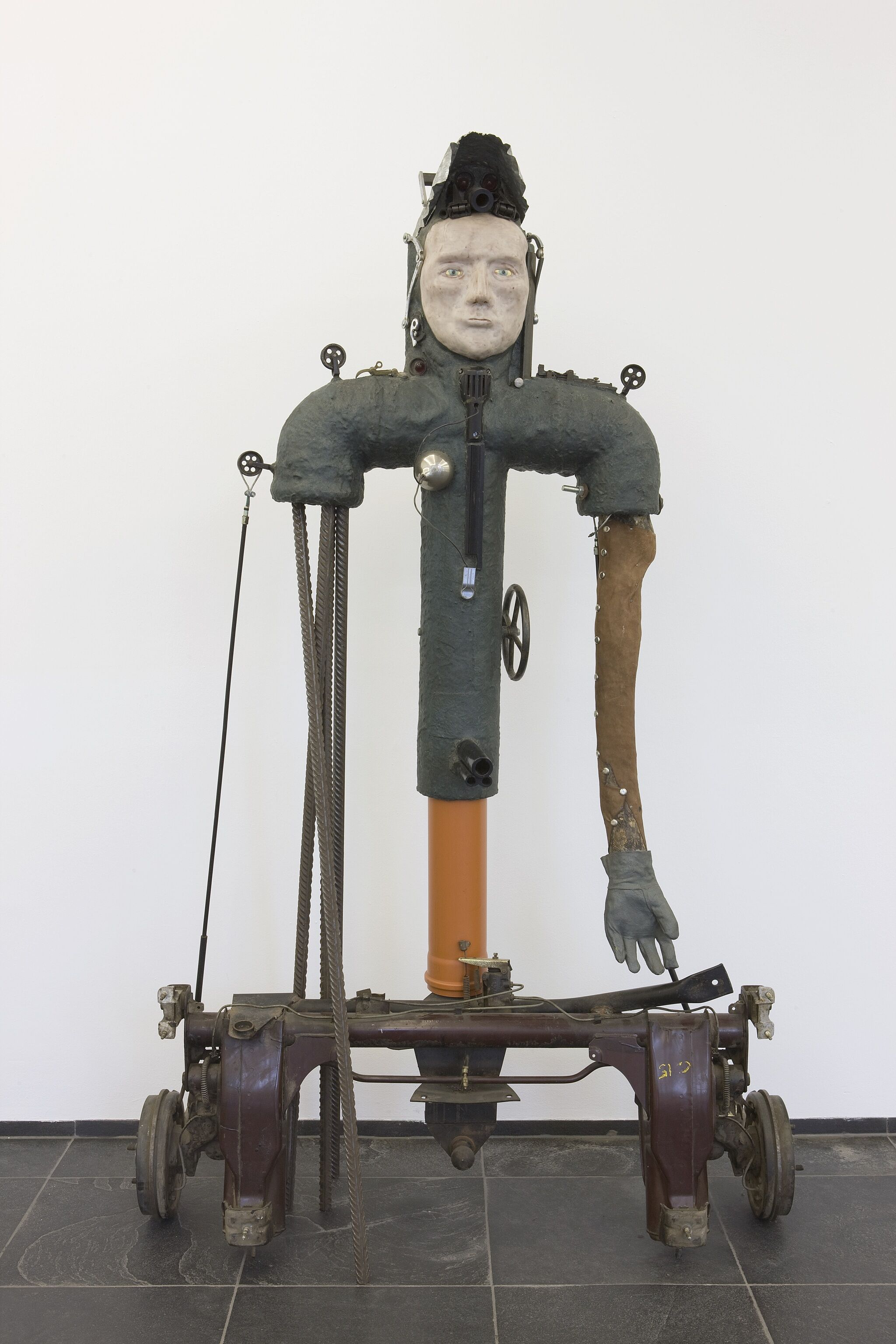 Abstract sculpture of a man with wheels