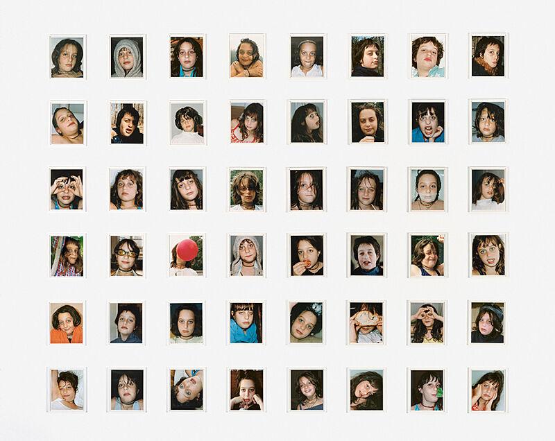 48 small portrait prints of children.