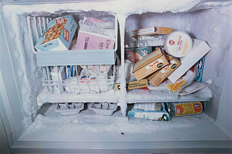 Photograph of freezer filled with boxed frozen food.