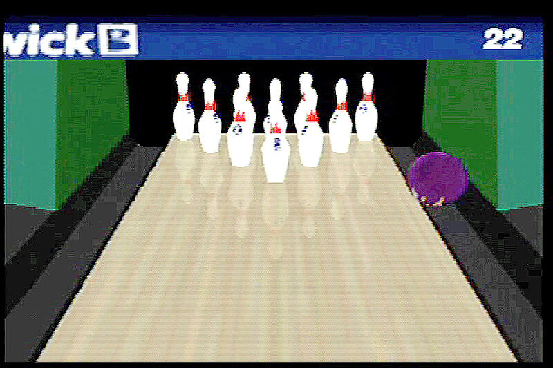 still image from bowling video game. Image depicts a close up of a gutter ball with all pins standing in the lane.
