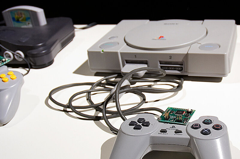 Close-up photograph of playstation controller and game system.