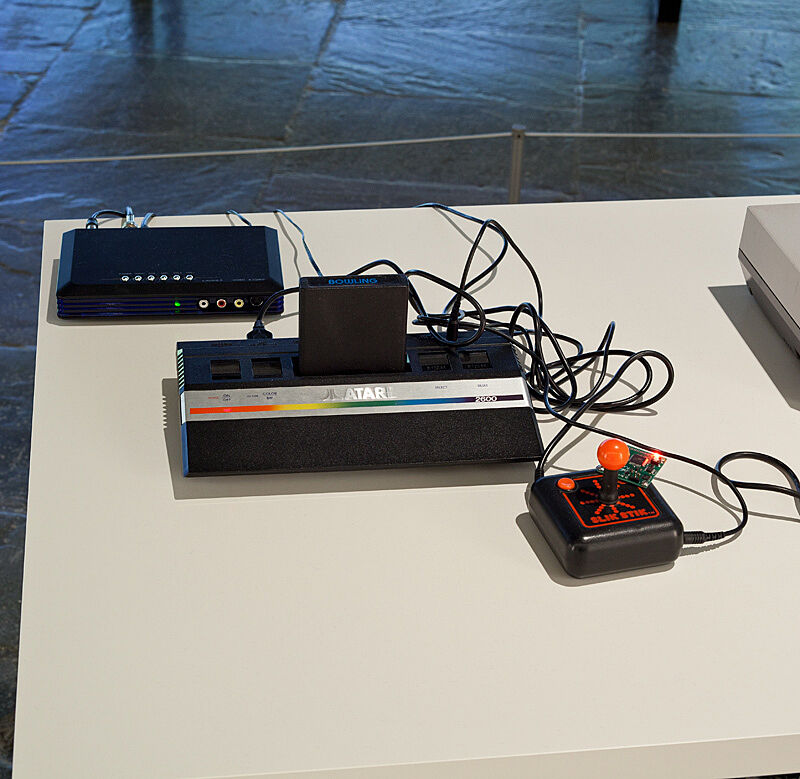 "Installation view of Various Self Playing Bowling Games (aka Beat the Champ) by Cory Arcangel. Image depicts vintage Avatar game system and ""Slik Stick"" controller."