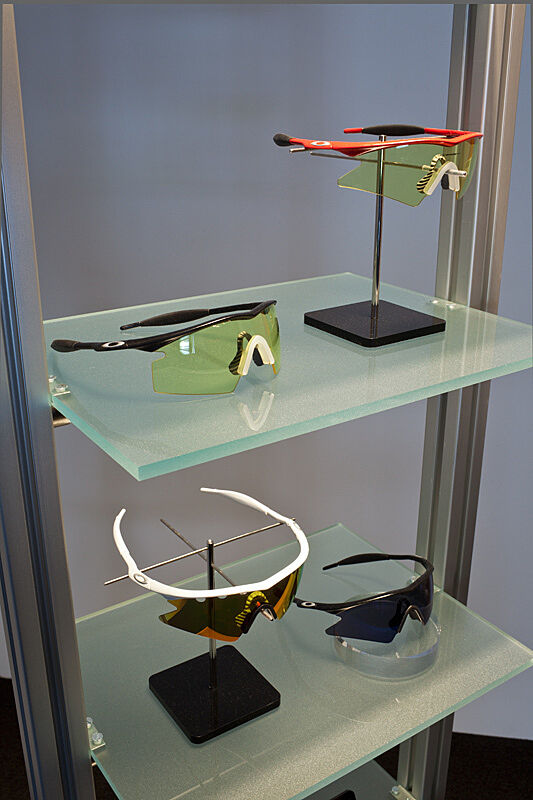 Photograph of a display of Oakley brand sunglasses.