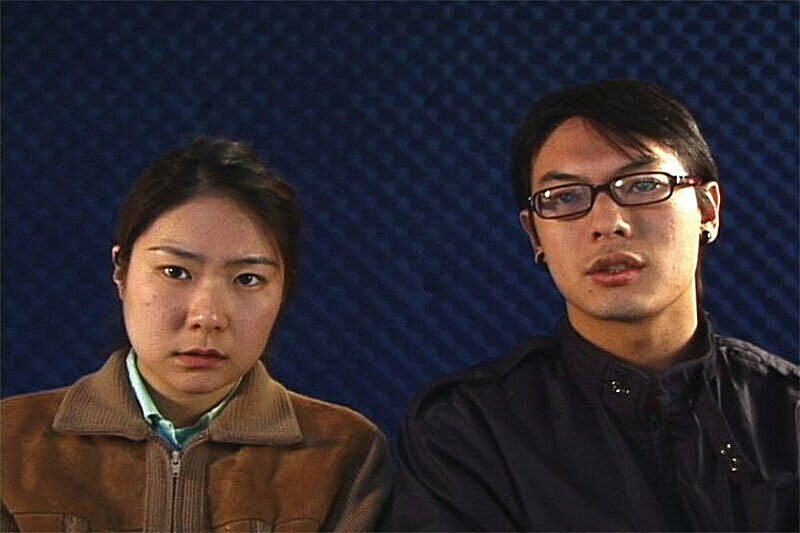 Two people against dark blue background.