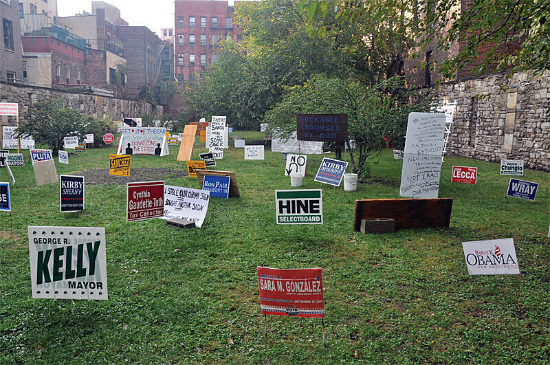 Grass with signs in it.
